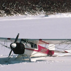 Small plane in Alaska that has landed in deep snow.