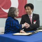 MSU president Waded Cruzado shaking hands with Mifune, Kumamoto, Japan mayor Masayuki Fujiki.