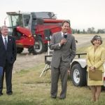 Commissioner of Higher Education Clay Christian, left, Montana Gov. Steve Bullock and MSU President Waded Cruzado take questions after an announcement of MSU research funded as part of the state's first large-scale research initiative Tuesday, Aug. 18, 2015 at the Arthur H. Post Research Farm near Bozeman. MSU photo by Kelly Gorham.