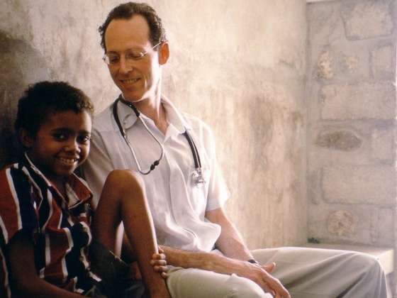 "Paul Farmer with one of his patients in ""Bending the Arc"""