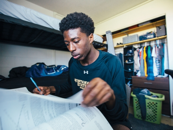 Men's basketball player Devin Kirby, a sophomore majoring in  business, currently does his homework in his room.  | Adrián Sánchez-González