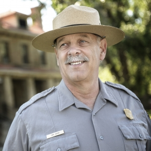 Yellowstone National Park superintendent Dan Wenk standing in front of park headquarters.