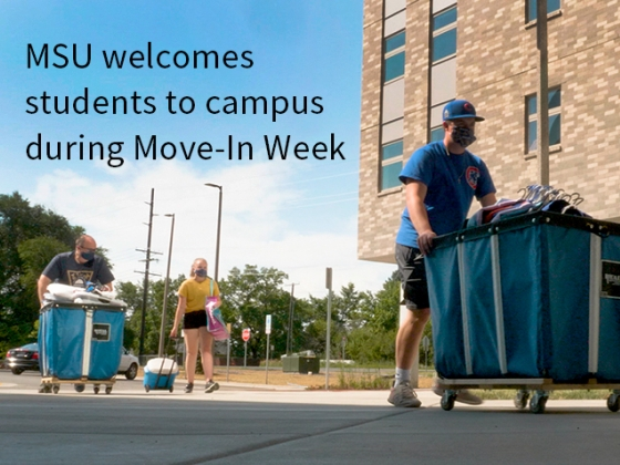 Students wearing face masks move their belogings into a residence hall at Montana State University. Move-in Week is Aug. 10-16. | Adrian Sanchez-Gonzalez/MSU