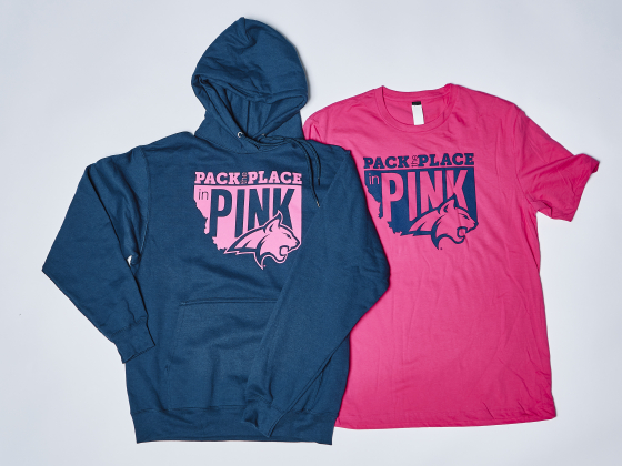 """A hooded sweatshirt and T-shirt both printed with the a logo for """"Pack the Place in Pink."""" 