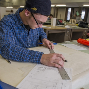 A student works on a blueprint