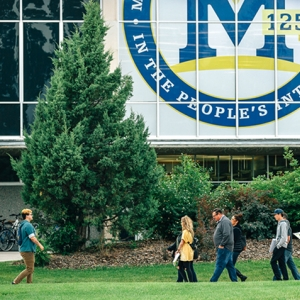A tour guide leads prospective students across Montana State University's campus in summer 2018. MSU will hold an orientation session June 25-27.