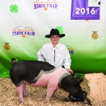 Local 4-H participant Blake Fitch is pictured with his pig Montana State University purchased at the recent Gallatin County Fair. Submitted photo.