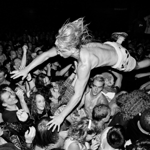 Stage dive during a live performance of Nirvana in downtown Seattle parking garage is part of the Sub Pop Records retrospective.