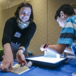 Anja Kunze demonstrates polarized light filters at the 2017 NanoDays / MicroDays event at Montana State University. MSU Photo by Adrian Sanchez-Gonzalez