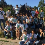 Japanese students and chaperones with Spirit the Bobcat
