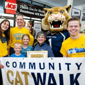 photo of students with a banner and Bobcat mascot