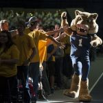 Champ greets students during convocation.
