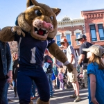 Champ greets a young Montana State University fan at the 2013 Bobcat Fest in downtown Bozeman. MSU photo by Kelly Gorham.