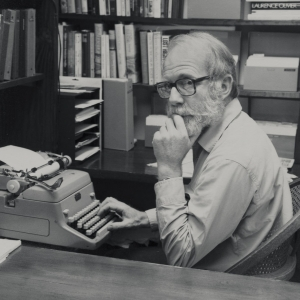 Ivan Doig sitting at his typewriter.