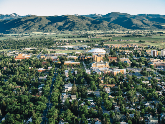 An aerial view of the campus of Montana State University, looking south with Gallatin Mountain Range in the background. | MSU Photo by Adrian Sanchez-Gonzalez