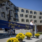 Tom Stumps, director of MSU Auxiliary Services, gives opening remarks during the ribbon cutting and grand opening ceremony of the new freshman residence hall, Yellowstone Hall, at Montana State University in Bozeman, Mont., on Tuesday, Aug. 16, 2016. MSU Photo by Adrian Sanchez-Gonzalez
