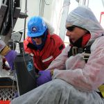 Montana State University graduate student Alex Michaud, left, and Brent Christner, associate professor of biological sciences at Lousianan State University, retrieve the first water sample from Subglacial Lake Whillans in January 2013 in West Antarctica. (Image courtesy of Reed Scherer).