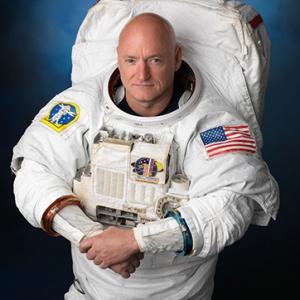 Astronaut Captain Scott Kelly poses in his suit