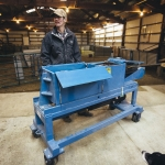 Wes Helle, a Montana State University animal range science student, shares insight on using a wool coring machine before testing wool fleece from Targhee-Rambouillet cross-breed sheep on Thursday, March 16, 2017, at the MSU Red Bluff Research Ranch, near Norris, Mont. The wool coring machine was designed by the Montana Manufacturing Extension Center for the MSU College of Agriculture's Wool Lab. MSU Photo by Adrian Sanchez-Gonzalez