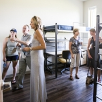 Students, faculty, guests and community members take a tour of the rooms inside the new freshman residence hall, Yellowstone Hall, after a ribbon cutting ceremony at Montana State University in Bozeman, Mont., on Tuesday, Aug. 16, 2016. MSU Photo by Adrian Sanchez-Gonzalez