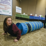 At the 2017 NanoDays / MicroDays event at Montana State University, Bozeman fifth-graders learn that if they were 50 micrometers tall, then a blue nylon tunnel would represent a strand of silk. MSU Photo by Adrian Sanchez-Gonzalez