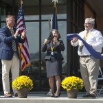 Montana State University Director of Residence Life Jeff Bondy (left), President Waded Cruzado and Director of Auxiliary Services Tom Stump cut a ceremonial ribbon to formally open Yellowstone Hall to the 2016 freshman residents. MSU photo by Kelly Gorham