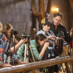 Image of instructor Jeffrey Conger and students making photos in the Old Faithful Lodge.