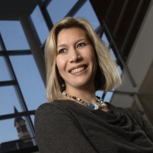 MSU professor Tricia Seifert posing in building stairwell.
