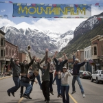 "Members of the ""Unbranded"" team jump for joy after learning the documentary was chosen as the audience choice award at the 2015 Telluride Mountainfilm Festival. Members of the team include, from left: Will Lake Springstead, Scott Chestnut, Korey Kaczmarek, Ben Masters, Dennis Aig, Paul Quigley, unidentified, Kristyn Birrell and Phillip Baribeau. Nearly all members of the production team are linked to MSU. Photo courtesy of Gravitas Ventures."
