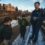 Samm Vankirk, right, a junior majoring in history at Montana State University, describes the process of building a pop-up museum on Monday, Dec. 12, 2016, using a dumpster to help illustrate World War I trench warfare for his history class. He is joined by fellow students Adam Negri, left, and Joey Morrison, center. The pop-up museum, located on MSU's Centennial Mall, across from the Renne Library, contains photographs, artifacts, and simulated trenches with informational posters of Montana's role in the World Wars. MSU Photo by Adrian Sanchez-Gonzalez
