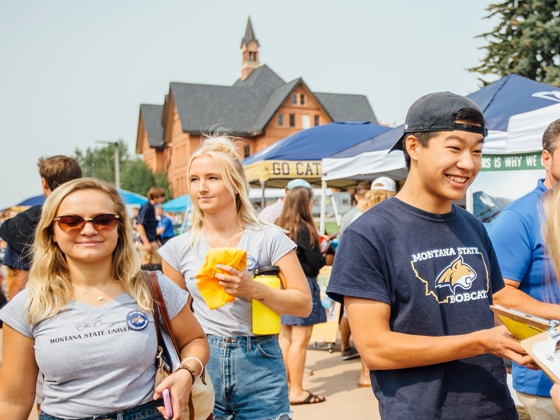Students walk along the Centennial Mall at Montana State University during a past year's Catapalooza event.