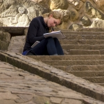 Allison Ross, a senior in environmental design at Montana State University, works on a drawing while sitting on the steps of an Inca ruin at Machu Picchu in Cusco, Peru, in May 2014. Ross was one of several MSU students who traveled to Peru with Henry Sorenson, professor of architecture in the College of Arts and Architecture at MSU, as part of a Study Abroad program. Photo Courtesy of Henry Sorenson