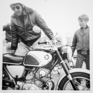 Author Robert M Pirsig and son with motorcycle in 1968.