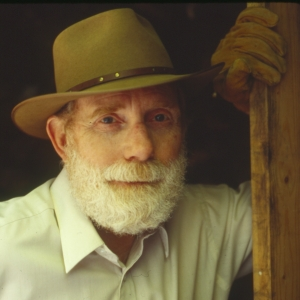 Ivan Doig leaning against woodhose door frame