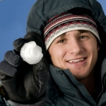 Alex Michaud analyzed some 200 hailstones from three storms in the Rocky Mountains near Bozeman and recently published his findings about them. In this photo, Michaud holds one of the hailstones that fell June 30, 2010 on Gallatin County. (MSU photo by Kelly Gorham).