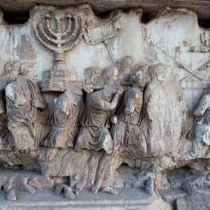 A photo of the spoils relief from the Arch of Titus in Rome.
