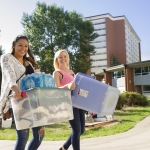 Students haul belongings to their new home at Montana State University during the 2015 annual Move In Day.