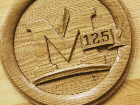 Detail of the MSU emblem carved on a wooden time capsule | MSU Photo by Adrian Sanchez-Gonzalez