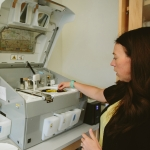 Hannah Estabrooks, lab manager for associate professor Jamie Sherman in the College of Agriculture at Montana State University, demonstrates equipment to process and test malt barley on Thursday, June 1, 2017, in Bozeman, Mont. Sherman recently received a $300,000 grant from the U.S. Department of Agriculture National Institute of Food and Agriculture to research barley varieties grown in Montana. MSU Photo by Adrian Sanchez-Gonzalez