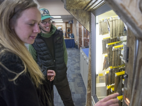 Students explore treasures in an art vending machine created by the Montana State University College of Arts and Architecture. | MSU photo by Kelly Gorham