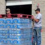 MSU agriculture staff members load pallets of bottled water to take to firefighters on eastern Montana's Lodgepole Fire Complex recently. Image courtesy of Nancy Hatfield.