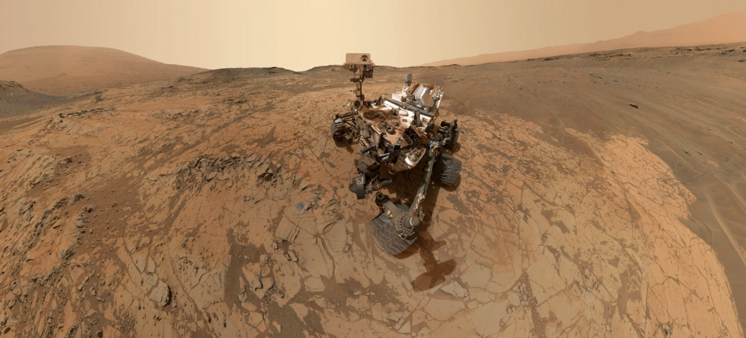 In this self-portrait, NASA's Curiosity rover stops at a site called Mojave, where it used its drill to analyze the local rock. The image is composed of dozens of photos taken by a camera at the end of the rover's robotic arm.
