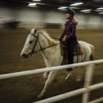 Montana State Intercollegiate Horse Show Association equestrian team member Kelly Nicholson practices western riding on Friday, Dec. 2, 2016, at the Bob Miller Livestock Pavilion in Bozeman, Montana. MSU Photo by Adrian Sanchez-Gonzalez