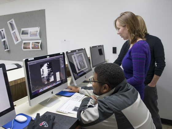 A film and photography student works on editing images.
