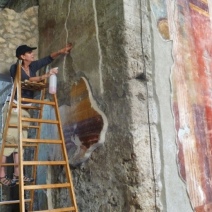 MSU art history professor specializing in ancient art, Regina Gee works on a fresco from Villa Oplontis in Italy. Gee will host a symposium Sept. 30 at MSU including presentations from an international panel of scholars from the fields of art history, arc