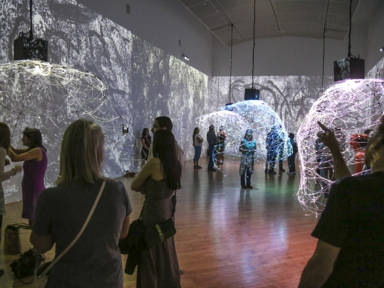 Visitors explore the CAVE exhibit opening at the Holter Museum in Helena. | MSU photo by Jason Bolte