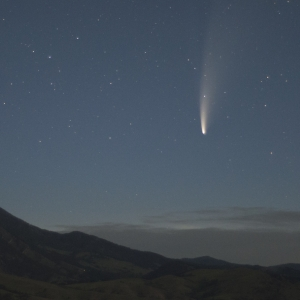 photo of comet NEOWISE at dawn with Bridger Mountains