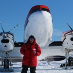 MSU graduate Alex Michaud is lead author of a paper that reveals that sediments from a lake beneath the West Antarctic ice sheet contain large amounts of methane. Michaud is shown here in front of a DC-3 turbine, one of the planes that flew scientists into the field in Antarctica. Photo courtesy John Priscu.