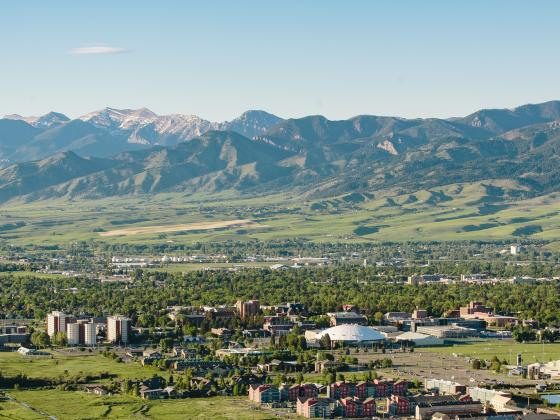 Aerial photo of Montana State University campus with Bridger Mountain Range in the background. | MSU photo by Adrian Sanchez-Gonzalez