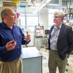 Montana State University Department of Microbiology and Immunology head Dr. Mark Jutila, left, takes Dr. Paul Offit on a tour of facilities at MSU on Friday, April 22, 2016.  MSU photo by Kelly Gorham